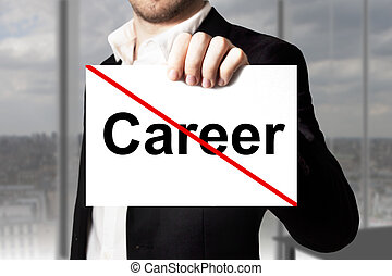businessman holding sign crossed out career