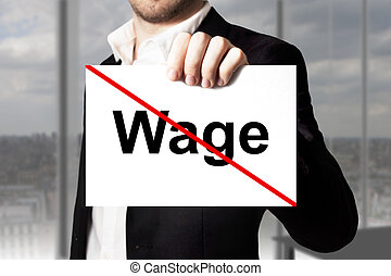 businessman holding sign wage crossed out