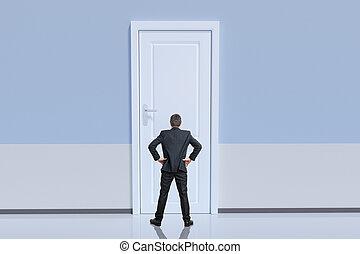 Businessman is standing behind big door. Opportunity and challen