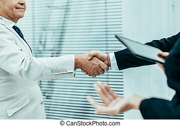 businessman shaking hands with his business partner.