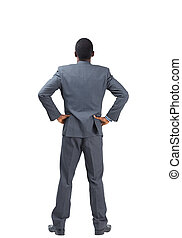 Businessman standing with hands on hips
