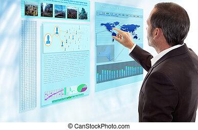 Businessman works with futuristic Display