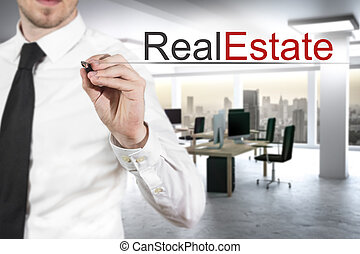 businessman writing real estate