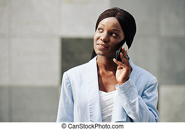 Businesswoman calling colleague