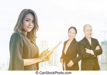 businesswoman holding tablet computer and smile,