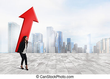 Businesswoman holds a big arrow. Concept of business growth and success