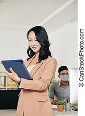 Businesswoman with tablet computer