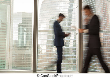 Busy businessman hurrying on business in office