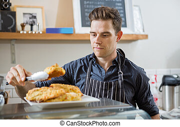 Cafe Owner Serving Sweet Food
