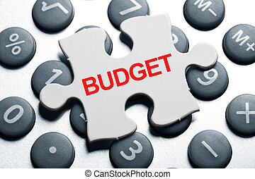calculator and Puzzle, business concept of Budget