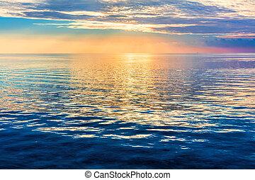 Calm ocean at sunset. Dramatic sky