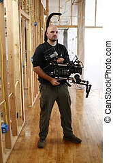 Cameraman with camera brace