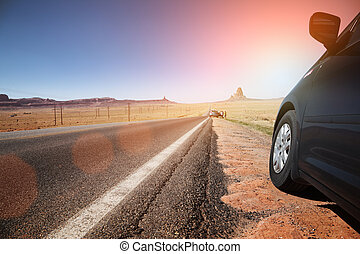 Car on highway leading to the horizon