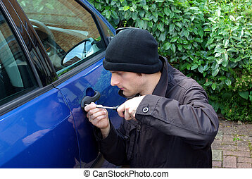 Portrait of a fake car stealer trying to force a car to open.