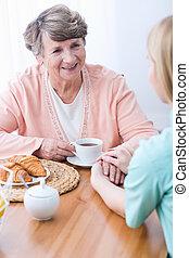 Carer keeping company senior woman