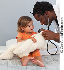 Caring Doctor with a child in a hospital