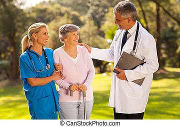 male doctor talking to recovering senior patient