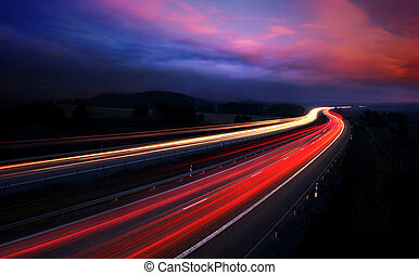 cars at night with motion blur.