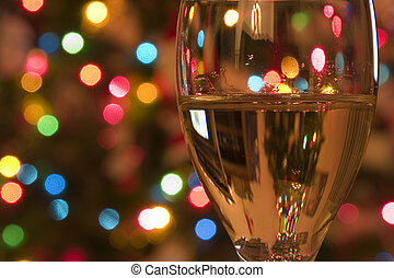 Close up on a Wine Glass with the Christmas lights on the background