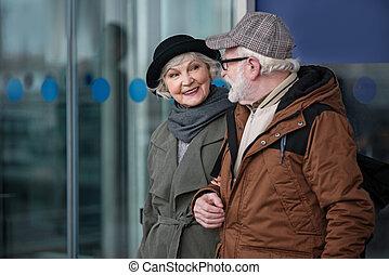 Charming senior lady is enjoying communication with aged man