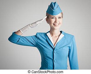 Charming Stewardess Dressed In Blue Uniform On Gray Background