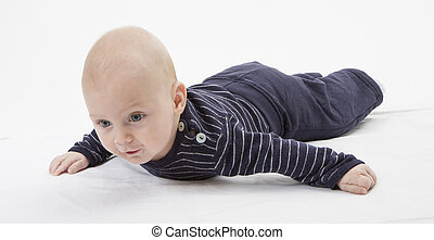 cheerful baby trying to get around