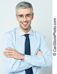 Cheerful corporate man with arms folded
