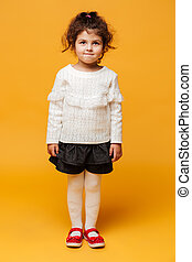 Cheerful girl child standing isolated