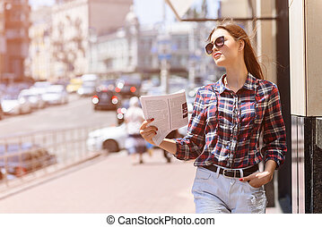 Cheerful girl saving from heat in city