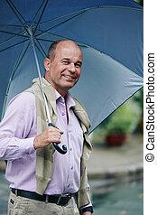 Cheerful man with umbrella