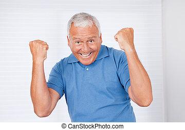 Portrait of cheerful senior man