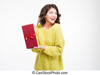Cheerful woman holding gift box