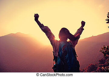 cheering woman hiker open arms