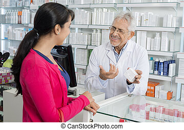 Chemist Gesturing While Communicating With Female Customer