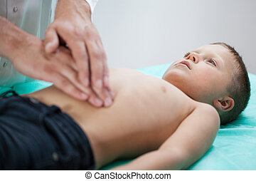 Child lying on examination couch