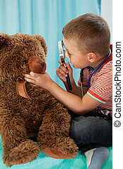 Child performs a medical examination