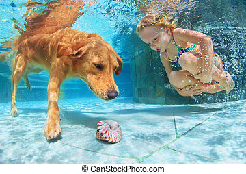 Child with dog dive underwater