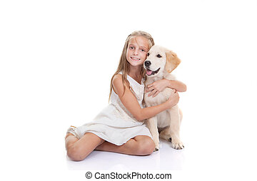 child with pet puppy dog