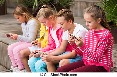 Children are playing on smartphone