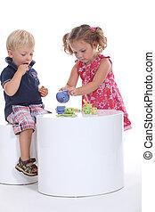 Children having tea together