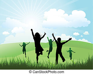 Silhouettes of children running and playing on a hill