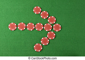 chips arrow pointing above green cloth