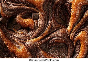 Chocolate cake crop macro texture, golden light, studio shot