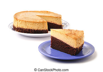 Slice of layered chocolate Mexican flan on plate next to whole pie on white background