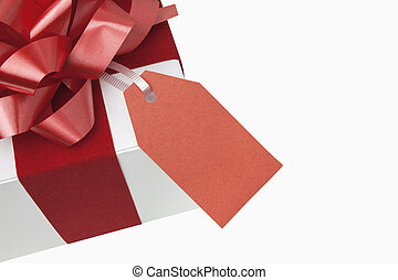 Christmas present with blank gift tag, includes clipping path