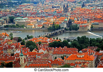 Cityscape: Prague aerial view, in the middle the famous Charles Bridge.