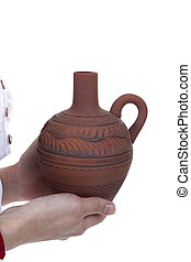 Clay pitcher in female hands