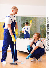 Cleaners with a broom