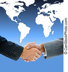 Close-up of a business people shaking hands against a white world map