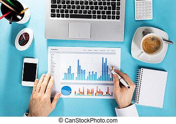 Businessman Analyzing The Graph